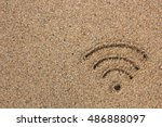 wi fi sign drawn in the sand | Shutterstock . vector #486888097