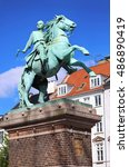 Small photo of Hojbro Plads Square with the equestrian statue of Bishop Absalon and St Kunsthallen Nikolaj church in Copenhagen, Denmark