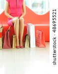 woman with bags in shopping mall   Shutterstock . vector #48695521