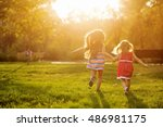 two sisters running on the lawn ... | Shutterstock . vector #486981175