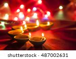 clay diya lamps lit during... | Shutterstock . vector #487002631