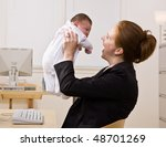 businesswoman holding baby at... | Shutterstock . vector #48701269