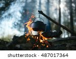 Cooking In A Pot Over Campfire