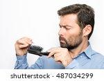 man losing hair | Shutterstock . vector #487034299