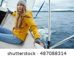 young woman sailing the boat | Shutterstock . vector #487088314