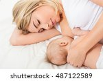 young mother breastfeeds her... | Shutterstock . vector #487122589