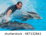 Riding On Two Dolphins. Show I...