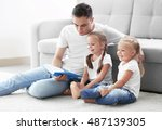 happy father with daughters... | Shutterstock . vector #487139305