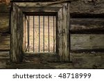 window of damaged wooden prison - stock photo