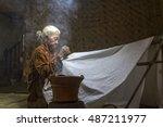 batik maker  a skillful old... | Shutterstock . vector #487211977