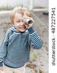 small boy with binoculars    Shutterstock . vector #487227541