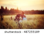 owner and dog labrador in field ... | Shutterstock . vector #487255189