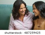 hispanic mother talking to her... | Shutterstock . vector #487259425