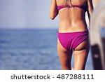 woman in pink bikini and sea  | Shutterstock . vector #487288111