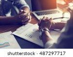 hand  two men on a desk.... | Shutterstock . vector #487297717