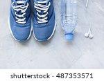 flat lay sport shoes  bottle of ... | Shutterstock . vector #487353571