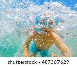 boy snorkelling in aegean sea ... | Shutterstock . vector #487367629
