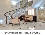 Staircase With Wrought Iron...