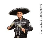 Small photo of Mariachi with maracas. Isolated on white background