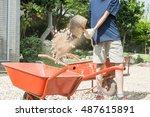 a shovel and wheel mortar cart. ... | Shutterstock . vector #487615891