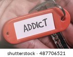 Small photo of ADDICT word written on key chain