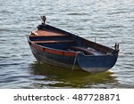 Anchored Old Rowboat And Its...