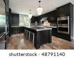 Stock photo kitchen in luxury home with dark wood cabinetry 48791140