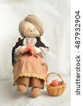 Doll Grandma Is Knitting On Th...