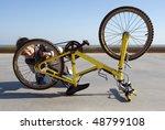 Child Fixing His Bike