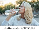young woman is drinking water... | Shutterstock . vector #488058145