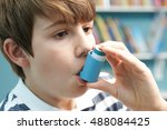 Small photo of Boy Using Inhaler To Treat Asthma Attack