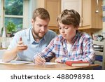 male home tutor helping boy... | Shutterstock . vector #488098981