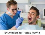 man having check up at dental... | Shutterstock . vector #488170945