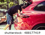 men cleaning car trunk after... | Shutterstock . vector #488177419