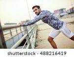 male runner doing stretching... | Shutterstock . vector #488216419