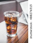 coke splashing from glass on... | Shutterstock . vector #488276515