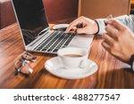 businessman hands on a rustic...   Shutterstock . vector #488277547