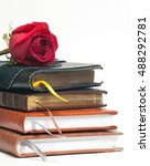 a stack of notebooks and a rose ... | Shutterstock . vector #488292781