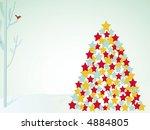 winter scene with bird in tree and xmas tree - stock photo