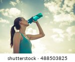 girl drinking bottle of water.  | Shutterstock . vector #488503825