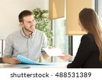 man giving a resume to the... | Shutterstock . vector #488531389