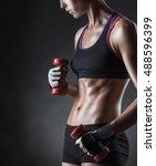 fitness girl with dumbbells on... | Shutterstock . vector #488596399