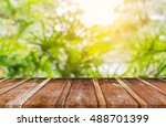 blur image of wood table and ... | Shutterstock . vector #488701399
