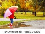happy child girl with umbrella...   Shutterstock . vector #488724301