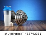 Stock photo dumbbell and whey protein shaker sports bodybuilding supplements or nutrition fitness or healthy 488743381