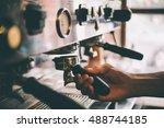 barista holds a portafilter... | Shutterstock . vector #488744185