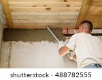 man repairs wall with spackling ... | Shutterstock . vector #488782555