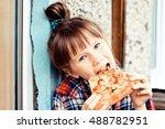 Child Enjoy Eating Pizza
