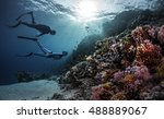 two freedivers swimming... | Shutterstock . vector #488889067