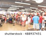 Stock photo blur image cashier with long line of people waiting at checkout counter in fitness store at outlet 488937451